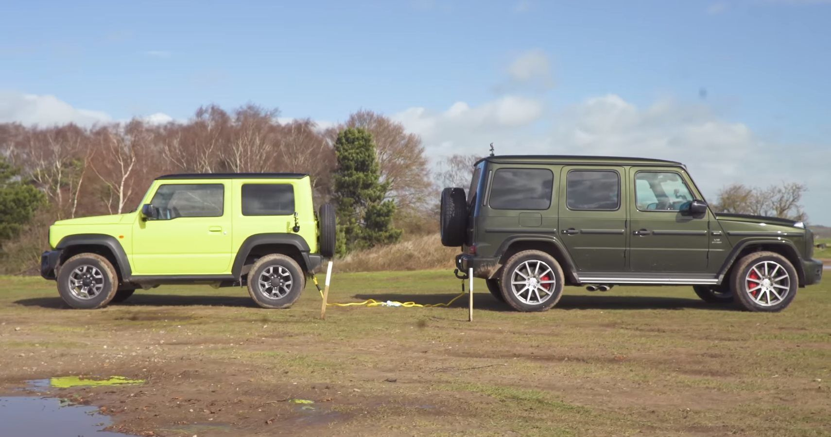watch a suzuki jimny take on a mercedes amg g 63 in a tug of war. Black Bedroom Furniture Sets. Home Design Ideas